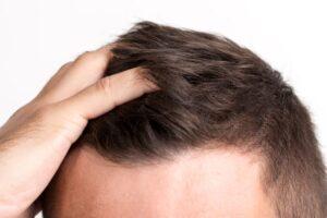 close up man touching his hair